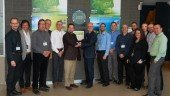 A part of the Sobeys Quebec team in front of the new LEED silver certification rating, distribution centre in Terrebonne. (CNW Group/IGA)