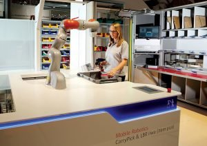Swisslog demonstrated the compatibility of its robotic picker and human workers at Modex. (Credit: Swisslog)