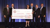 Top Tech winner Darek Mowinski shows off his $50,000 check alongside his wife Carlene and (from left to right) Ryder executives Bill Dawson, VP of Maintenance & Engineering; Robert Sanchez, Chairman & CEO; Dennis Cooke, President of Fleet Management Solutions; and Tom Havens, SVP & Chief of Operations. (Photo: Business Wire)