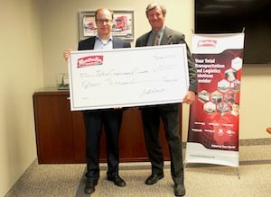 Jeff Smith, (L) executive vice-president Manitoulin Transport and Manitoulin Group of Companies presents cheque to John Grant, program director, midwestern Ontario, Nature Conservancy of Canada.