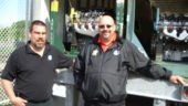 Warehouse manager Lance Lund (left) and driver Guy Broderick prepare to unload engines at the downtown Toronto school.