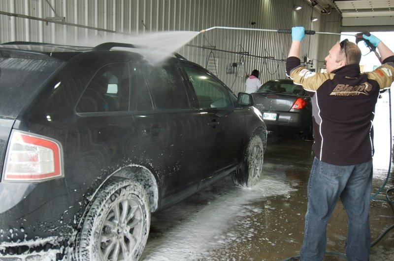 Bison Transport staff will be washing cars at the company's Winnipeg terminal tomorrow afternoon to raise money for the upcoming CancerCare Manitoba Challenge for Life walk for cancer.