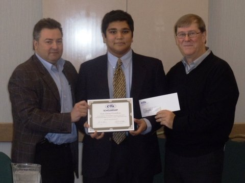 Fatin Chowdhury accepts CIFFA's $3,000 scholarship prize during an association meeting in December. Also pictured are CIFFA president Marc Bibeau (left) and immediate past president Robert Walker (right).