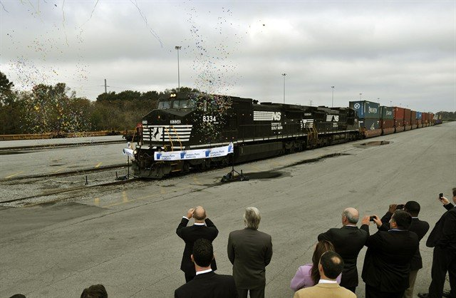 Two Norfolk Southern 4,400-horsepower locomotives break a ribbon during a ceremony celebrating the grand opening of the Georgia Ports Authority James D. Mason intermodal container transfer facility in Savannah, Ga earlier today.