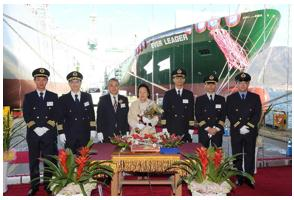 Bronson Hsieh, second vice-group chairman of Evergreen Group (third left), Sook-Je Lee, sponsor for the new ship's rope cutting (centre) and the crew of Ever Leader, pose during a naming ceremony earlier today.