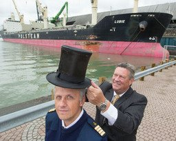 """Port of Toronto Harbour Master Angus Armstrong (right) ""crowns"" Captain Jacek Kurpiel (left) with a nearly 200-year-old silk and beaver top hat at the Toronto Port Authority's 153rd Beaver Hat Ceremony today to welcome the M/V Lubie, the first ocean vessel for 2014 to the Port of Toronto. The ceremony is an annual event and Port tradition dating back to 1861 to mark the commencement of the shipping se! ason. (CNW Group/Toronto Port Authority)""."