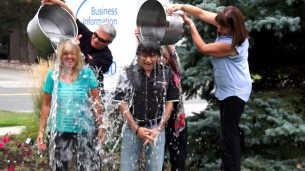 Truck News' Associate Publisher Kathy Penner, and Publisher Lou Smyrlis get doused in ice bucket challenge