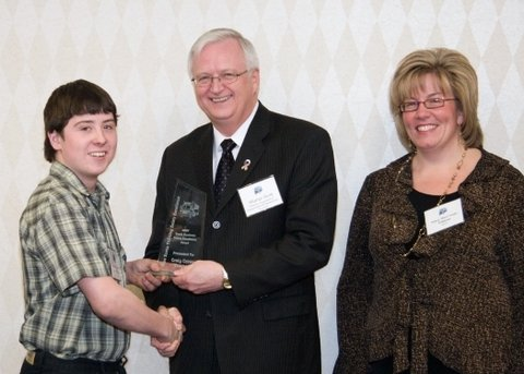 Bradley Crowe, son of Craig Crowe Trucking owner, Craig Crowe, accepts the Small Business Safety Excellence Award on behalf of his father. The awards were presented during the Nova Scotia Trucking Safety Association's annual general meeting in Halifax Feb. 27.