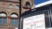 Organizer Scott Mooney parked his truck at Queen's Park with a strong message on its grille.