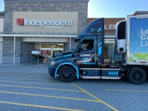truck in front of grocery store
