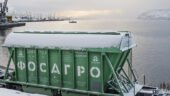 Self-unloading bunker freight cars in the territory of the Murmansk Commercial Sea Port awaiting unloading